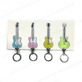 Appendichiavi con quattro portachiavi a forma di chitarra